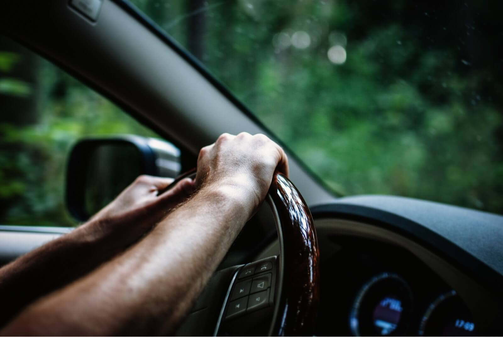 hand on steering wheel - Patterson Intellectual Property Law